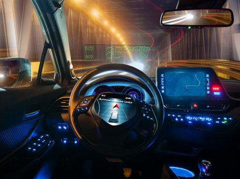vision of an autonomous car driving at night in a lighted tunnel
