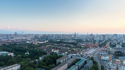 Wall Mural - time lapse of xian cityscape at dusk to night, beautiful giant wild goose pagoda and city road with skyline in nightfall, shaanxi province, China