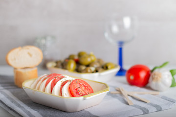 mozzarella with tomatoes and olives