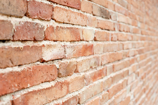 Old red brick wall background with  perspective