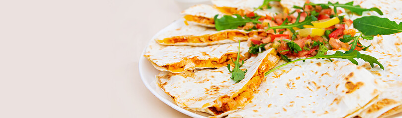 Delicious quesadilla with chicken, corn and salsa. Banner.