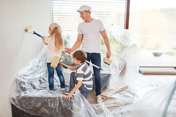 Children paint wall while renovating