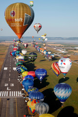 Hundreds of hot air balloons attend the Mondial Air Ballons festival in Chambley