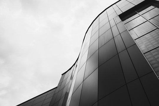 modern office building with a curved facade. black and white image