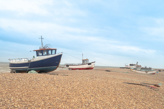 Fishing boats on the shingle beach waiting to go back out to the water, Dungeness, Kent