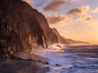 Spray from a storm blows up the cliffs at dawn in the seaside town of Sidmouth, Devon