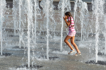 girl playing with water works