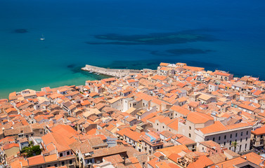 View over the colourful tiled rooftops of the Old Town from La Rocca, Cefalu, Palermo, Sicily, Mediterranean