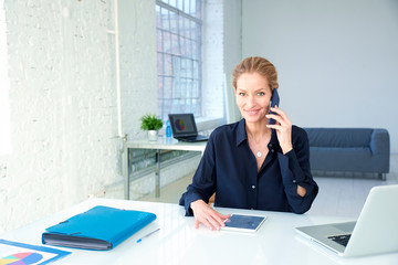 Working businesswoman talking with somebody on her cell phone