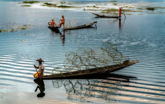 Life skills unique fishing culture, a large lagoon native Myanmar. Unique way of life skills fisherman.