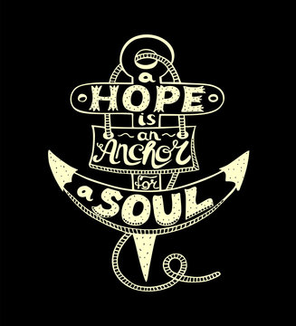 Hand lettering with bible verse A Hope is anchor for the soul on a black background.