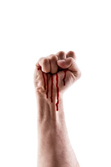 Raised hand showing fist with blood isolated on white background