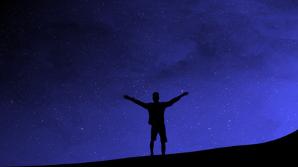 Silhouette of man on a background of the sky. Man enjoys freedom Wall mural