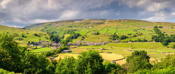 Panorama of Gunnerside Village and Meadows, in Swaledale one of the most northerly dales in the Yorkshire Dales National Park, famous for its wildflower meadows and field barns Fototapete