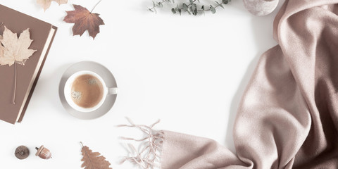 Autumn home cozy composition. Dried autumn leaves, cup of coffee, book, scarf, flowers on white background. Fall background. Flat lay, top view, copy space Fototapete