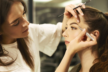 Brow Artist Plucking And Shaping Girl's Brows In Beauty Studio