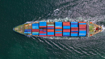 Aerial view container ship carrying container in import export business logistic and transportation of international by container ship in the open sea. - fototapety na wymiar