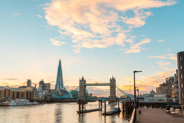 London view at sunset with Tower Bridge and modern buildings