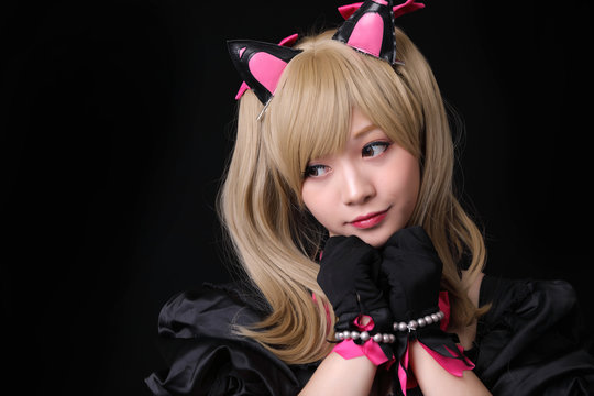Japan anime cosplay , portrait of girl cosplay isolated in black background