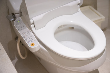 electronic control panel of toilet sanitary ware with automatic flush system, japan toilet bowl. Fototapete