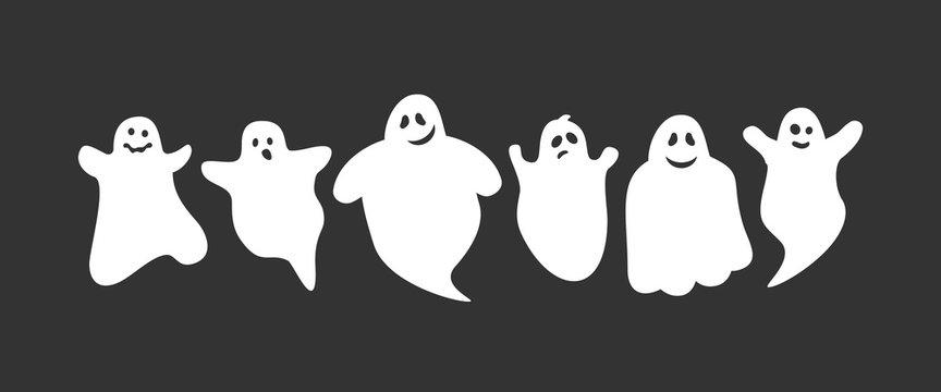 cute cartoon ghosts set on black background