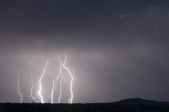 Lightning striking around a farm silo during the 2015 monsoon season in Arizona.