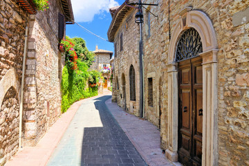 Wall Mural - Stone buildings lining a ancient medieval street in the old town of Assisi, Italy
