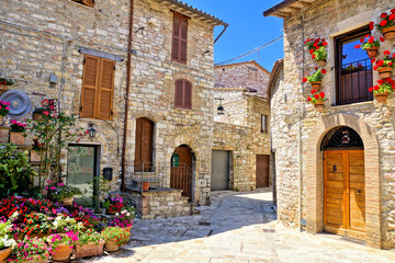 Wall Mural - Beautiful stone buildings of the flower filled old town of Assisi, Italy