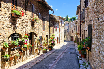 Fototapete - Stone buildings lining a ancient medieval street in the old town of Assisi, Italy