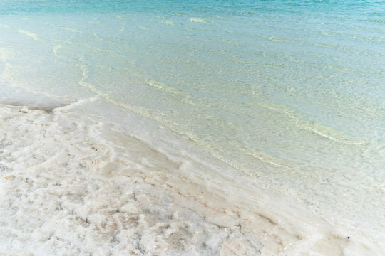 The Dead Sea located in Israel where people to go to swim, float, vacation, and relax in the sun while enjoying its healing properties.