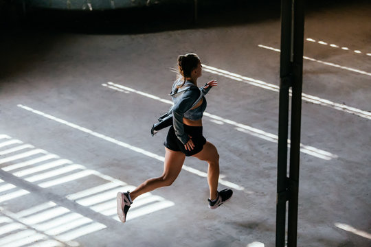 Young woman running indoors