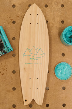 Deck of skateboard with logotype