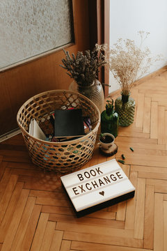Book exchange light sign with lot of books in the basket