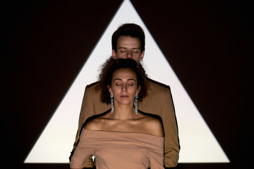 Couple Posing Against Projection