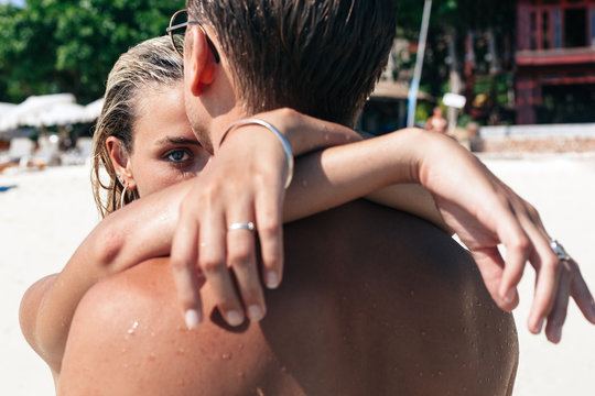 Close up of couple hugging on beach