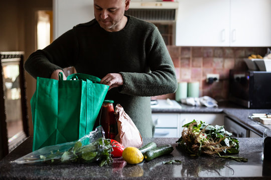 Unpacking food shopping in the kitchen
