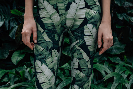 Midsection of woman wearing camouflage standing in forest