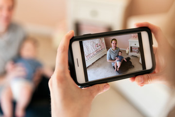 Family: Parent Taking Photo With Cell Phone