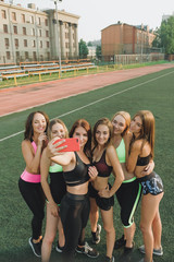 team girls athletes make a group selfi