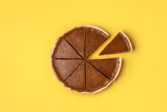 Pumpkin pie cut in slices and one separated