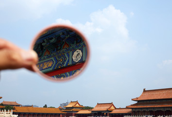 The details of the Forbidden City building are seen in the mirror. Forbidden City, Beijing, China.