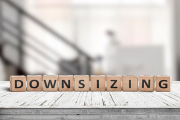 Downsizing message sign made of wood