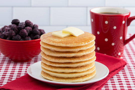 A Stack of Freshly Made Pancakes on a Gingham Tablecloth