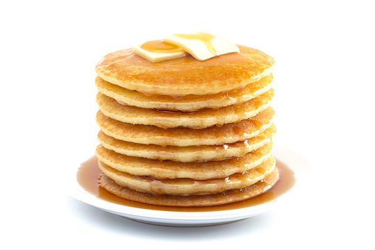 Stack of Freshly Made Pancakes with Syrup and Butter Isoalted on a White Background