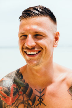 Portrait of smiling man on the beach