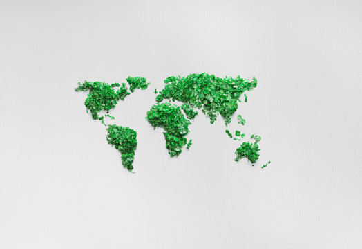 Green world map on white paper background