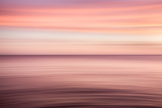 A red and purple blurred seascape background