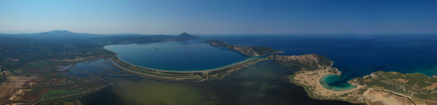 Aerial drone photo of iconic round shaped exotic sandy beach of Voidokoilia in the heart of Messinia, Gialova, Peloponnese, Greece