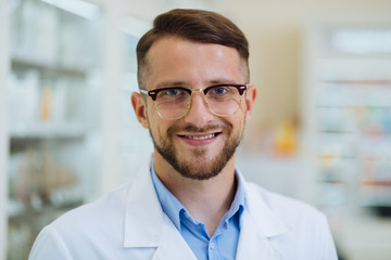Close up of kind chemist that demonstrating his smile