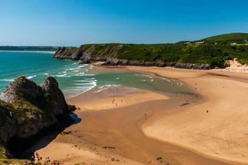 A huge, golden sandy beach at low tide (3 cliffs bay, Wales) Fototapete